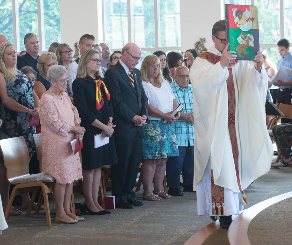 Basilian Father Kevin Mannara, director of campus ministry at St. John Fisher College, walks toward the altar at the new Hermance Family Chapel of St. Basil the Great Sept. 17.