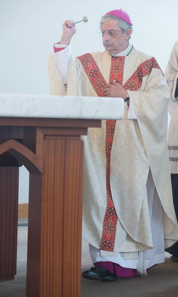 Bishop Salvatore R. Matano blesses the altar at St. John Fisher College's new Hermance Family Chapel of St. Basil the Great Sept. 17.