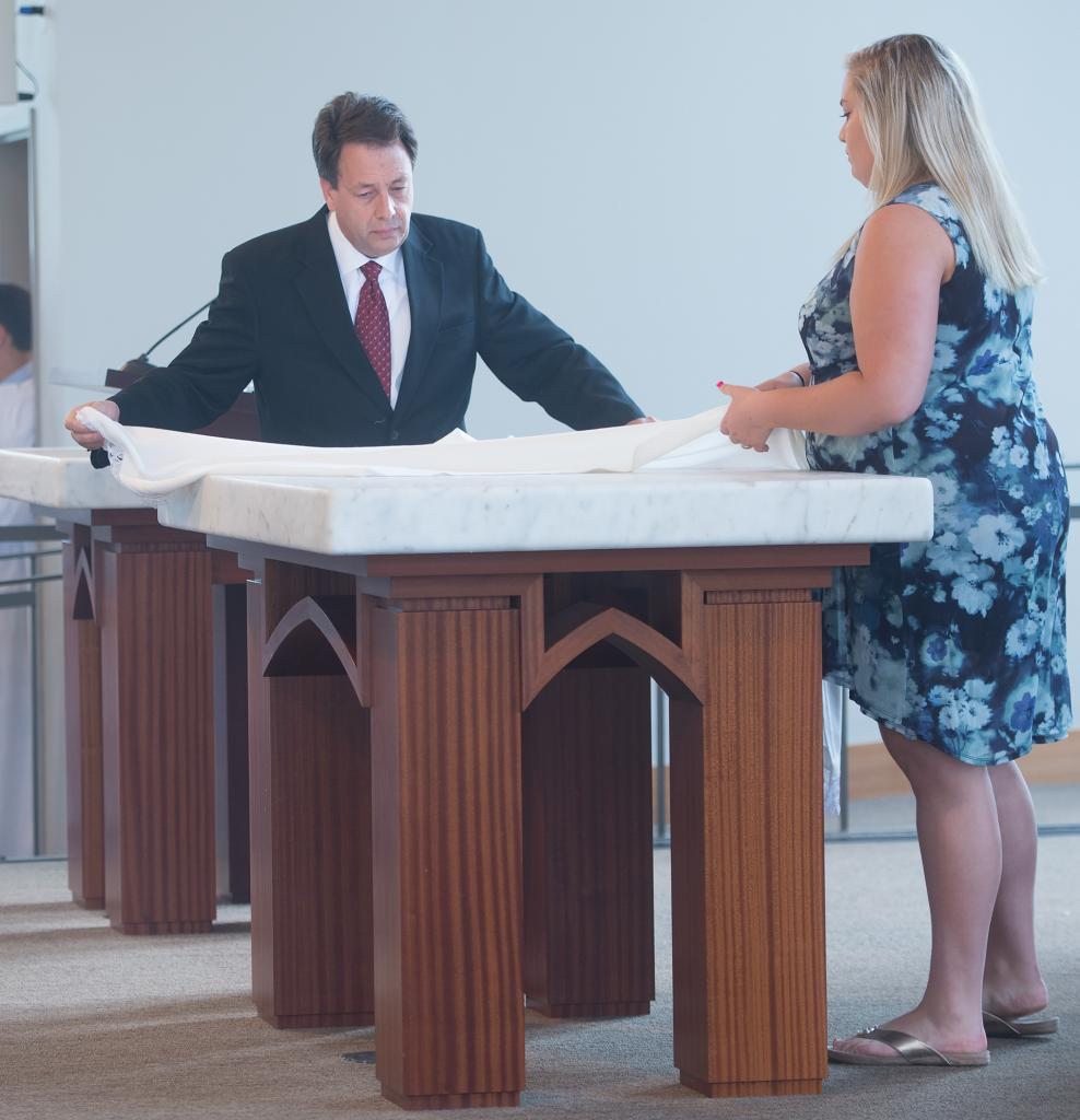 Orrie Capone and Gina Capone prepare the altar during the first Mass held in the new Hermance Family Chapel of St. Basil the Great at St. John Fisher College Sept. 17.