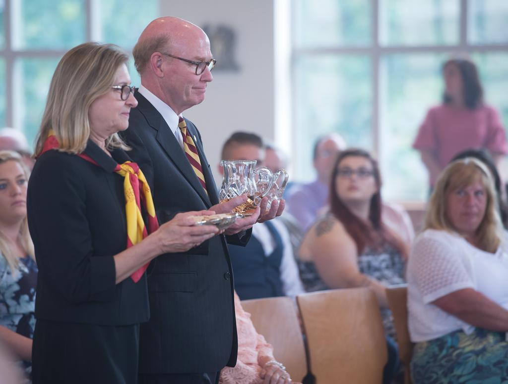St. John Fisher College President Gerard J. Rooney and Susan Rooney present the gifts during the first Mass held in the new Hermance Family Chapel of St. Basil the Great at St. John Fisher College Sept. 17.
