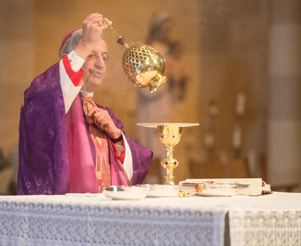 Bishop Salvatore R. Matano prepares for Communion.