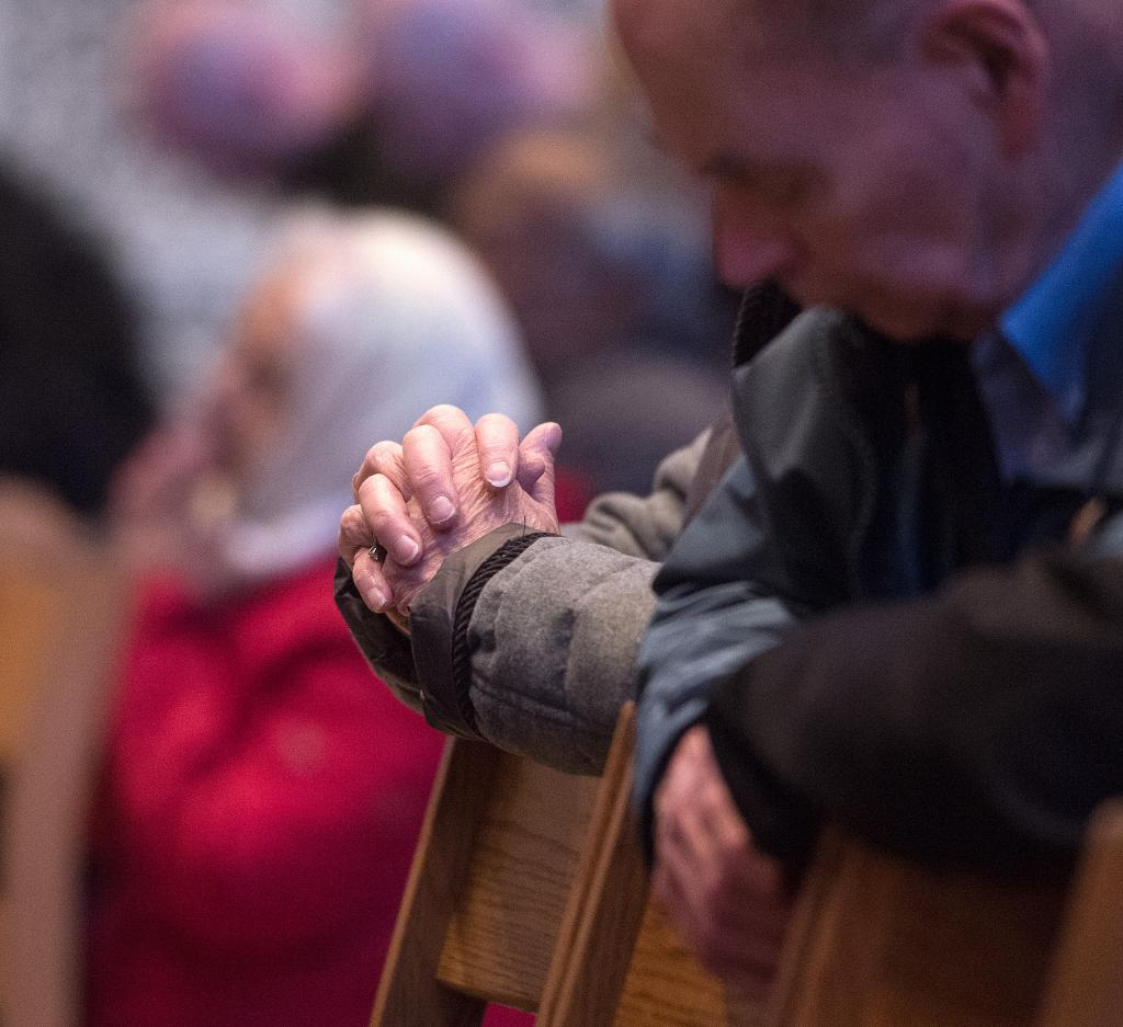 Worshippers pray during the Mass.