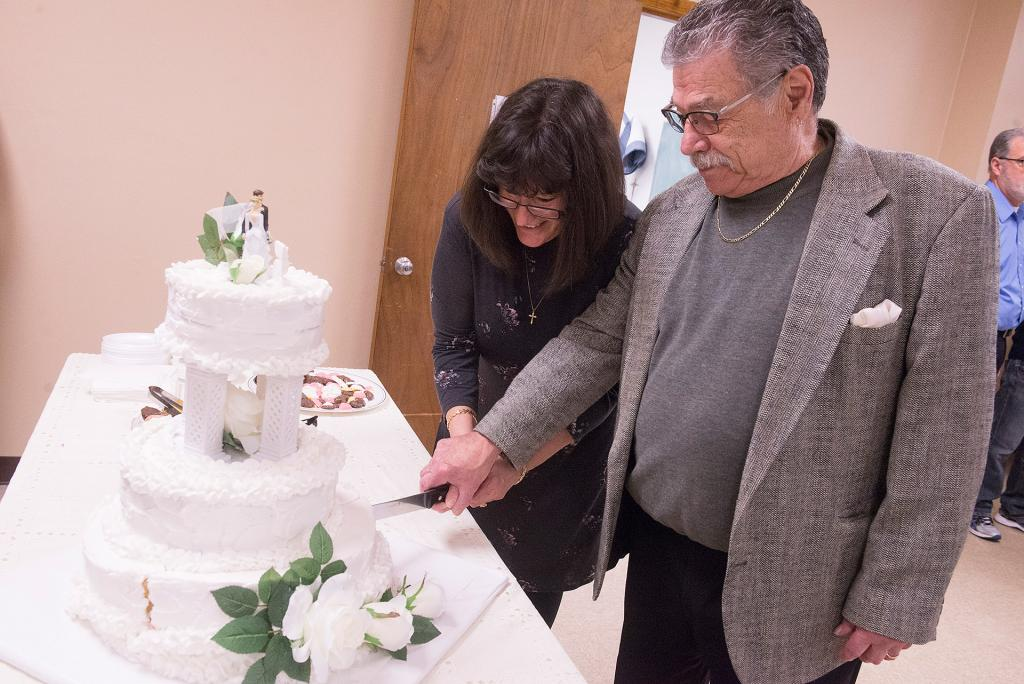 Lisa and Dominick Morano, who have been married for 35 years, cut the cake during the reception.<br />  (Courier Photo by John Haeger)