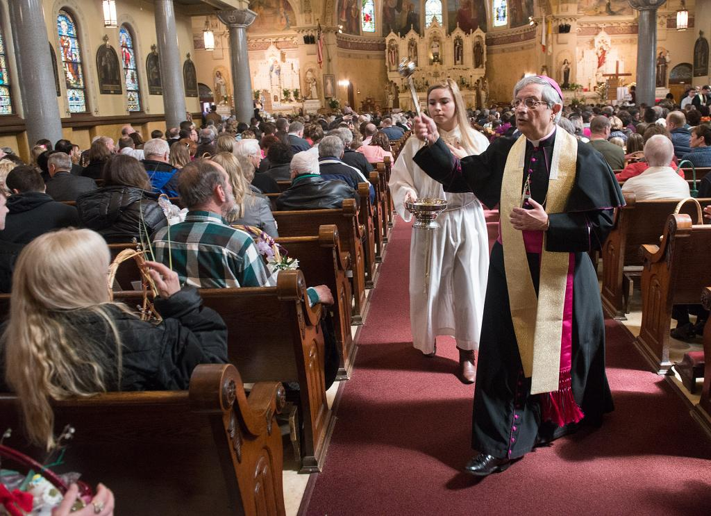 Bishop Salvatore R. Matano blesses Easter baskets at St. Stanislaus Kostka Church in Rochester during the annual Easter food blessing March 31. in Rochester. (Courier Photo by John Haeger)