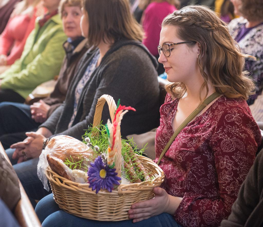 Sabnna DeVos holds her Easter basket of food. (Courier Photo by John Haeger)