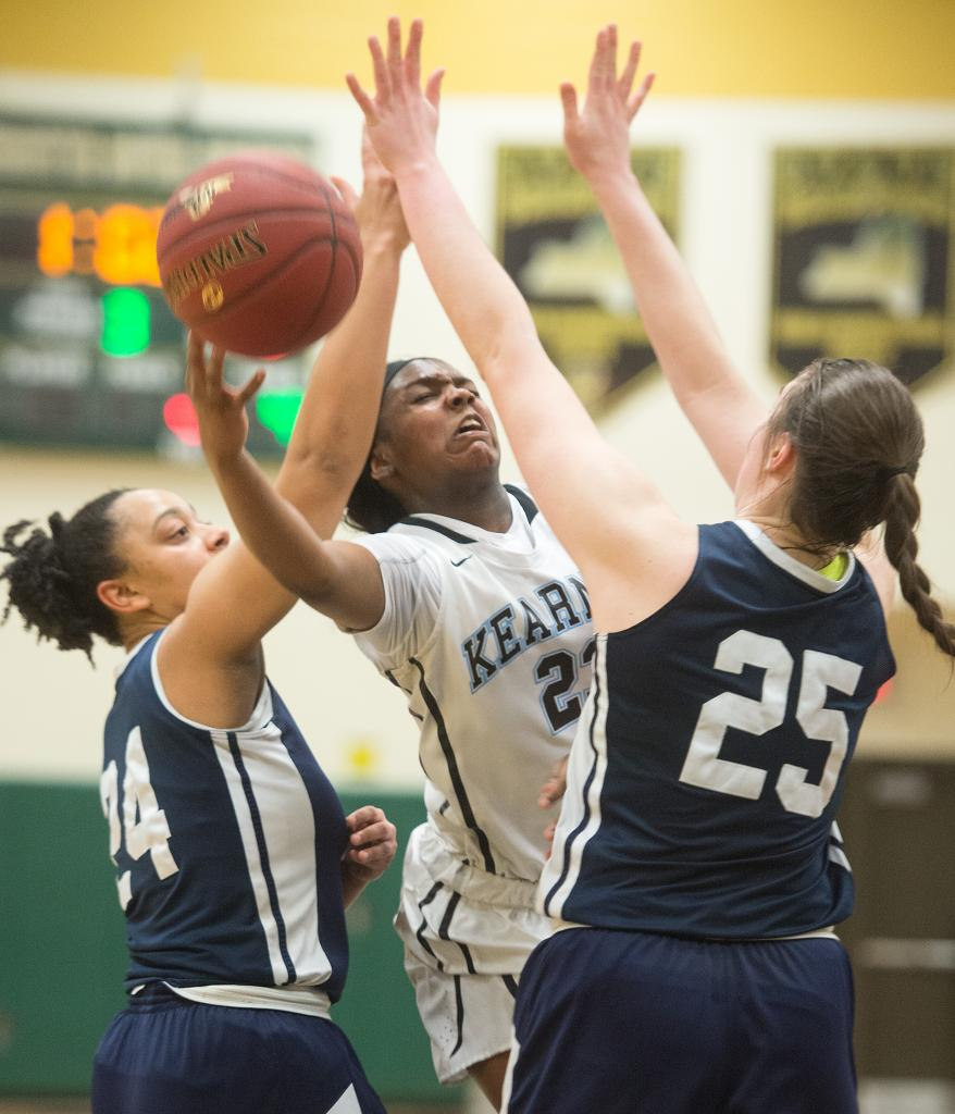 Bishop Kearney's Saniaa Wilson (21) drives the lane for two as Mercy's Traiva Breedlove (24) and Katie Titus (25) defend in the fourth quarter of the Section 5 Class AA sectional championship game March 3. (Courier Photo by John Haeger)