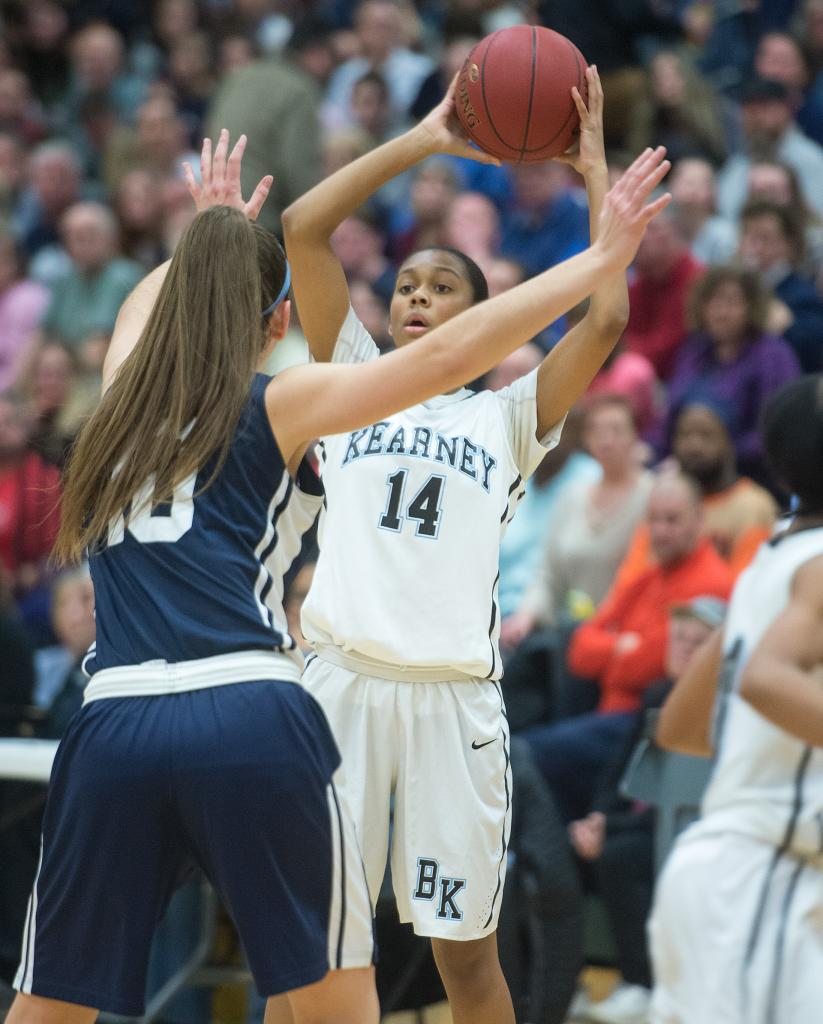 Bishop Kearney's Camille Wright (14) looks to pass as she is pressured by Mercy's Leah Koonmen (10) in the third quarter of the Section 5 Class AA sectional championship game March 3.(Courier Photo by John Haeger)