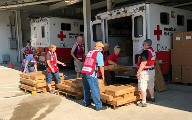 <p>Red Cross workers unload supplies during relief efforts in Houston. </p>