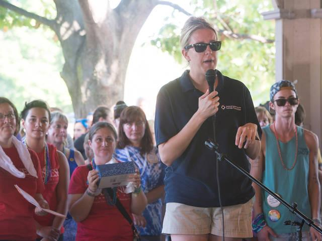 <p>Sarah Clark, of The American Foundation for Suicide Prevention Western New York Chapter, address walkers before the start of the Out of the Darkness Community Walk Sept. 24 at Genesee Valley Park in Rochester.