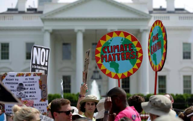 <p>Protesters carry signs during the People's Climate March April 29 outside the White House in Washington. The U.S. bishops June 1 urged President Donald Trump to honor the nation's commitment to the Paris climate pact and protect the planet.  </p>