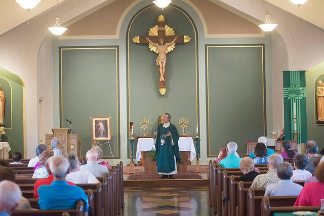 "<p>Father William ""Mickey"" McGrath speaks to congregants during Mass at Annunciation Church in Rochester Sept. 23.  </p>"