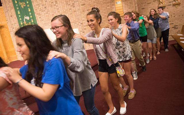<p>Youths take part in the Life Teen Mass at Church of the Assumption in Fairport Sept. 17.  </p>