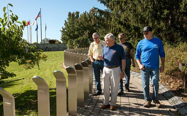<p>Vietnam veterans Jerry McDermott (from left), Chuck Macaluso, Stan Patykiewicz and Ron Trovato walk the grounds of the Vietnam Memorial in Rochester's Highland Park Oct. 20.  </p>