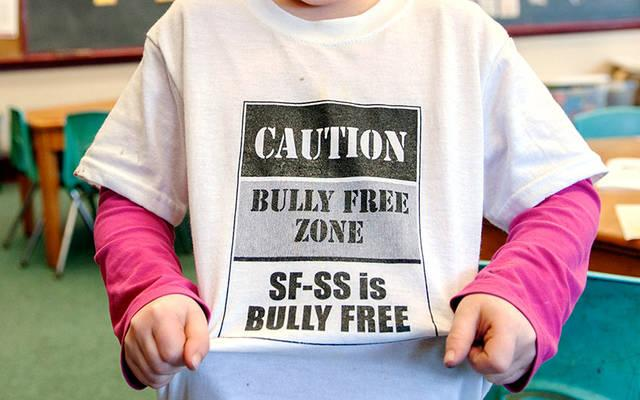 <p>A student wears an anti-bullying shirt for a skit at St. Francis-St. Stephen School in Geneva as part of Catholic Schools Week Jan. 28, 2014. (File photo)  </p>