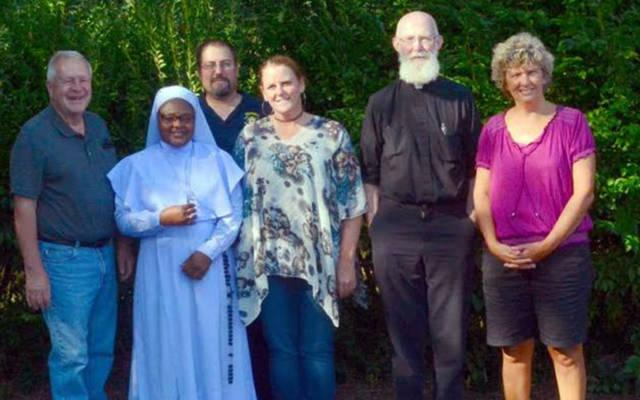 """<p>Jim Claire (from left); """"Sister Stan"""" Terese Mario Mumuni; Grand Knight Gary Mikolajczyk and Amy Mikolajczyk of Our Lady of the Valley Parish; Father John Cullen; and Jen Spoth of St. Mary's Church of Canaseraga are involved in raising funds for a van that will benefit an orphanage in Ghana.  </p>"""