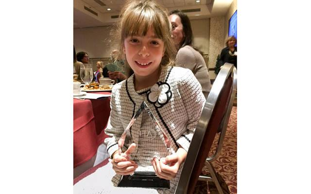 <p>Eight-year-old Maia Bastianelli holds her Outstanding Youth in Philanthropy Award from the Association of Fundraising Professionals.  </p>