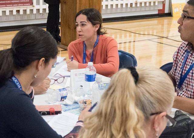 <p>Ana Carolina Torres, a member of Nativity of the Blessed Virgin Mary Parish in Brockport, participates in the diocesan encuentro gathering in Rochester Oct. 21.  </p>