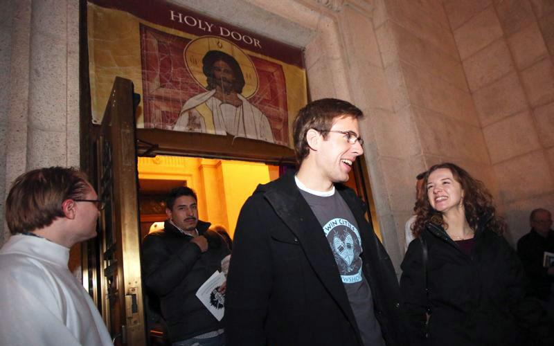 """Jonathan Thompson and Julia Waletzko exit the Holy Doors at the Basilica of St. Mary in Minneapolis Nov. 20, 2016, just hours after they got engaged. """"Love needs time and space; everything else is secondary,"""" Pope Francis writes in """"Amoris Laetitia"""" (""""The Joy of Love""""). (CNS photo by Dave Hrbacek/The Catholic Spirit)"""