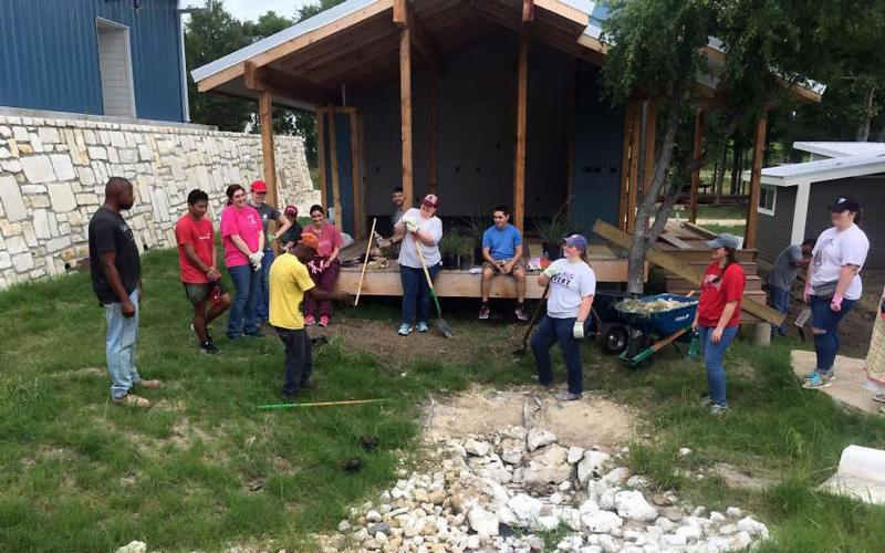 Students from Arkansas colleges participating in a mission trip organized by the Diocese of Little Rock, Ark., help out May 16, 2017, at a community in Austin, Texas, that offers permanent residence to homeless people. Pope Francis emphasizes that every Christian is called to be a missionary by virtue of his or her baptism. (CNS photo by Arkansas Catholic courtesy of Catholic Campus Ministry of the Diocese of Little Rock)