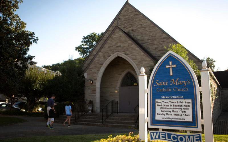 Visitors of the Great Smoky Mountains National Park near Gatlinburg, Tenn., prepare to enter St. Mary's Catholic Church near the city's main drag Aug. 14, 2016. If we don't want to take a vacation from our vocation, then Mass should be included in our vacation planning. (CNS photo by Chaz Muth)