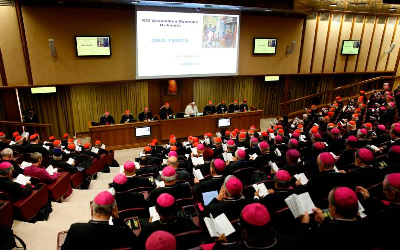 """Pope Francis presides at the morning session of the Synod of Bishops on the family in 2015 at the Vatican. The concept of """"synodality,"""" originally applied to bishops meeting together to discuss church teaching, has become increasingly important and extended since the Second Vatican Council. (CNS photo by Paul Haring)"""
