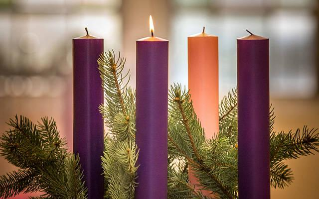 <p>A lit candle is seen on an Advent wreath in this 2016 photo. We remember that God's first miracle, light, is also his most frequent.  </p>