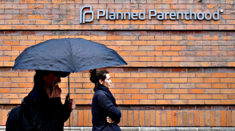 People pass a Planned Parenthood clinic March 17 in New York City.