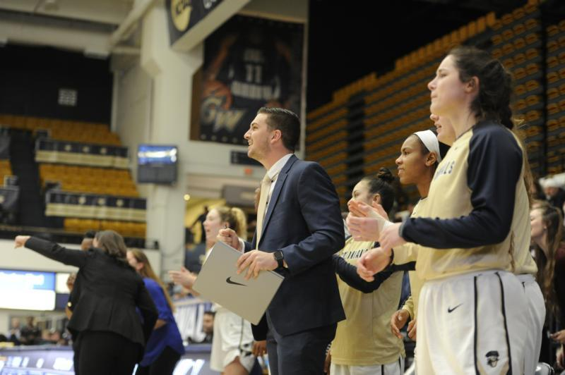 Kevin DeMille, center, a graduate of Notre Dame High School in Lawrenceville, N.J., is now an assistant coach for the George Washington University women's basketball team in Washington.