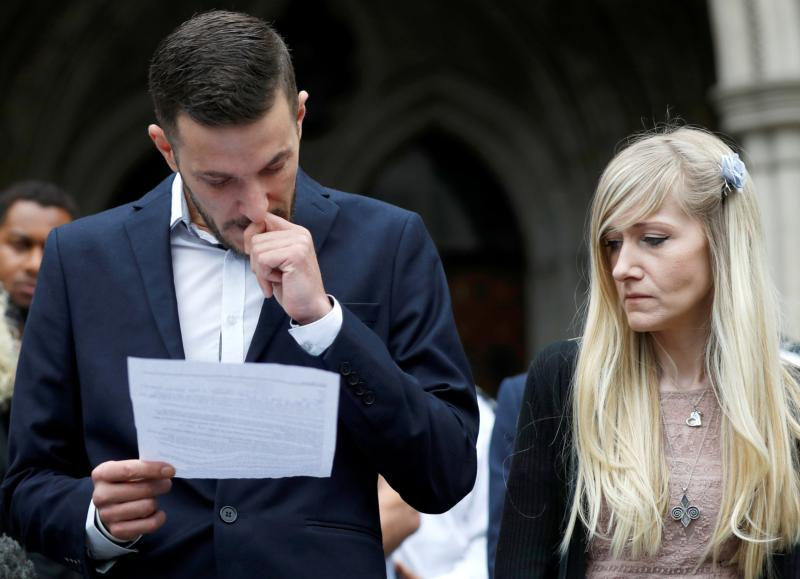Connie Yates and Chris Gard read a statement outside London's High Court July 24 after a hearing on their baby's future. The British couple's baby, Charlie Gard, who was at the center of a legal battle that captured the world's attention, died July 28, just over a one week before his first birthday.