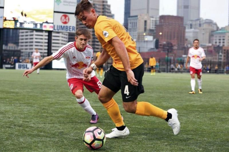 Pittsburgh Riverhounds soccer player Taylor Washington, right, plays in a United Soccer League game against the New York Red Bulls II at Highmark Stadium in Pittsburgh. Washington went to Iona Preparatory in New Rochelle, N.Y., for three years, where he developed a greater appreciation for his Catholic faith and started to deepen his relationship with God.