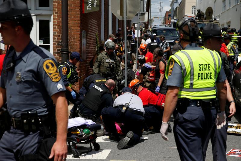 Rescue workers assist people who were injured when a car drove through a group of counter-protesters during a white nationalist rally in Charlottesville, Va., Aug. 12. Cardinal Daniel N. DiNardo of Galveston-Houston, president of the U.S. Conference of Catholic Bishops, condemned the violence and hatred and offered prayers for the family and loved ones of the person who was killed, and for all those who were injured.