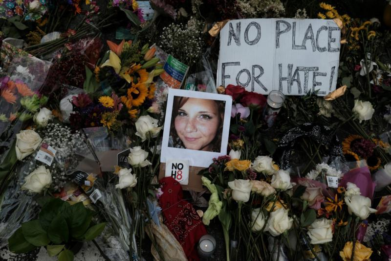 A photograph of victim Heather Heyer is seen Aug. 14 among flowers where the car attack on a group of white nationalist counter-protesters took place Aug. 12. Heyer was killed when a car was driven into the crowd.