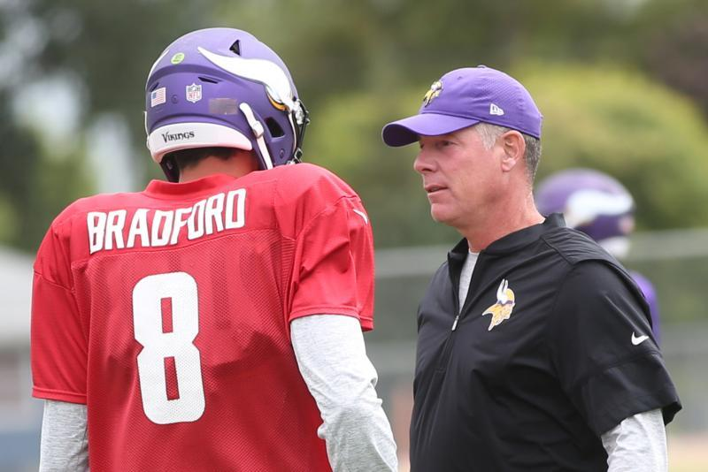 "Minnesota Vikings offensive coordinator Pat Shurmur talks with quarterback Sam Bradford during practice Aug. 3 at Minnesota State University, Mankato. ""My Catholic faith influences really every facet of my life,"" Shurmur said. ""I've always believed it's a terrific guideline for living and certainly has carried over to coaching."""