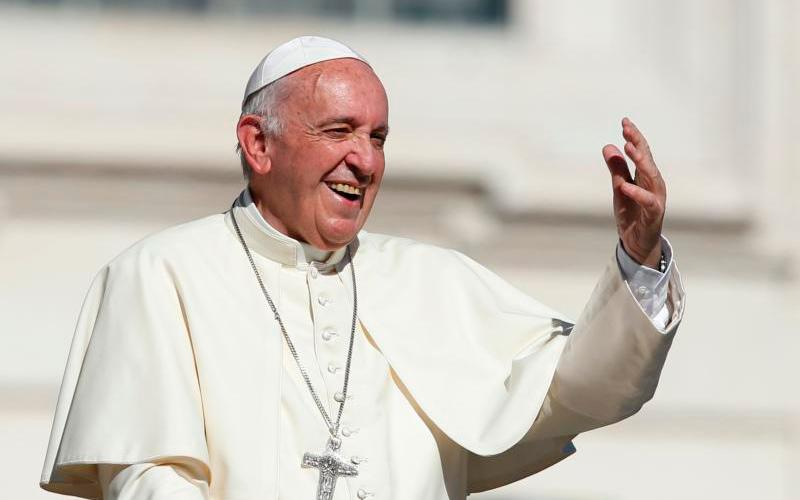 Pope Francis gestures as he leaves his general audience in St. Peter's Square at the Vatican Oct. 11.