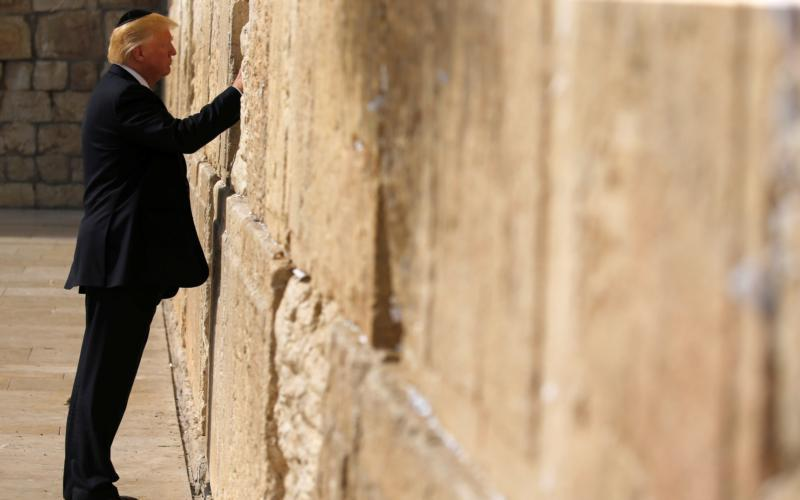 CNS photo/Jonathan Ernst, Reuters U.S. President Donald Trump places a note in the Western Wall in Jerusalem May 22. Following reports that Trump planned to recognize Jerusalem as the capital of Israel, Pope Francis expressed his concern that such a move would further destabilize the Middle East. (CNS photo by Jonathan Ernst/Reuters)