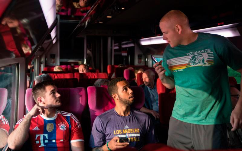 """Alek Skarlatos, Anthony Sadler and Spencer Stone portray themselves in the movie """"15:17 to Paris."""" While on a backpacking trip in 2015 through Europe, their Paris-bound train was attacked by a terrorist and the three childhood friends were able to subdue him, saving the lives of the more than 500 passengers on board the train. (CNS photo courtesy Warner Bros)"""