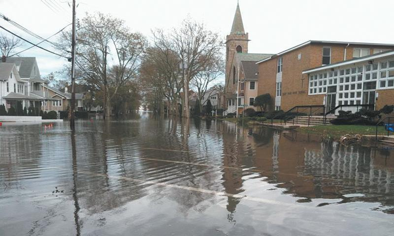 Floodwaters from Superstorm Sandy swamp the area around St. Rose Parish and its grammar and high schools in Belmar, N.J., during Superstorm Sandy in 2012. A change in Federal Emergency Management Agency policy may mean federal funds for religious organizations and houses of worship affected by hurricanes Harvey and Irma. (CNS photo by courtesy Ginny Blasi)