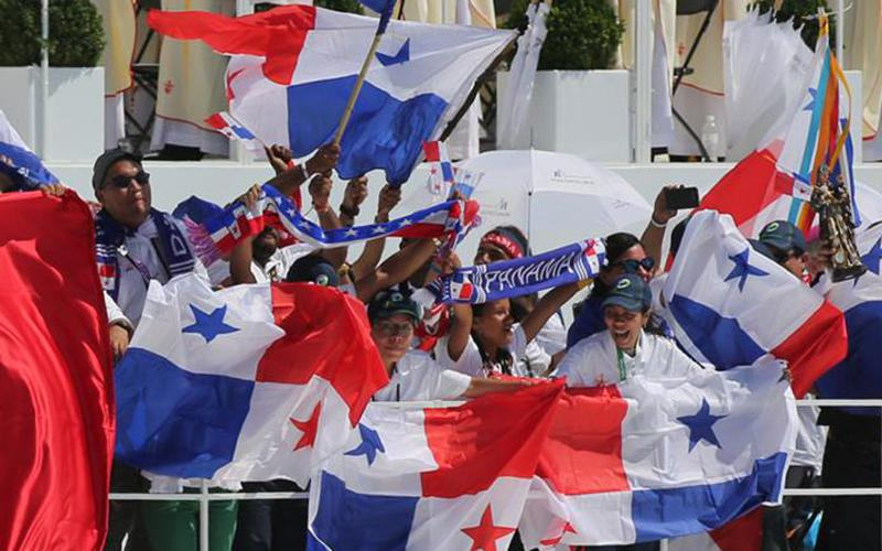Young people wave Panamanian flags after Pope Francis celebrated the World Youth Day closing Mass in 2016 at the Field of Mercy in Krakow, Poland. (CNS photo by Bob Roller)