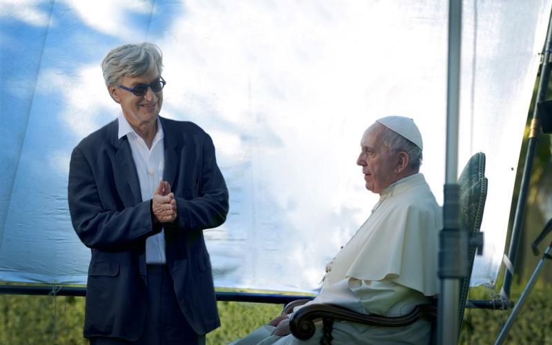 "German filmmaker Wim Wenders is pictured in this undated photo with Pope Francis during the production of his documentary film, ""Pope Francis -- A Man of His Word."" The film was compiled from four long sit-down sessions with the pope and from clips of the pope at the Vatican and abroad. It is scheduled for release in theaters May 18. (CNS photo/Vatican Media, handout)"
