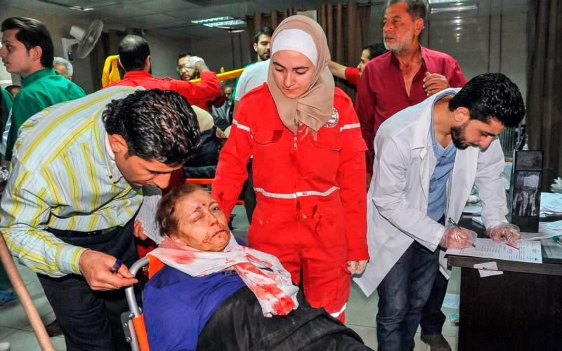 A wounded Syrian woman receives aid at a hospital April 7 in Damascus after a suspected chemical-weapon attack in Douma. Pope Francis condemned the use of chemical weapons after the deadly attack killed dozens of innocent men, women and children. (CNS photo by SANA via EPA)