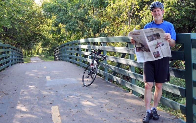 Bishop Thomas R. Zinkula of Davenport, Iowa, poses for a photo alongside his bicycle along Duck Creek in Davenport.Bishop Zinkula will be riding in RAGBRAI XLVI, the Register's Annual Great Bicycle Ride Across Iowa in July, with a group from his diocese. The noncompetitive ride is organized by The Des Moines Register daily newspaper. (CNS photo by Lindsay Steele/The Catholic Messenger)
