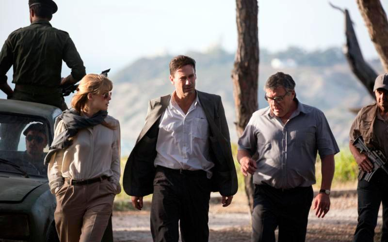 "Rosamund Pike, Jon Hamm and Dean Norris star in a scene from the movie ""Beirut."" The Catholic News Service classification is A-III -- adults. The Motion Picture Association of America rating is R -- restricted. Under 17 requires accompanying parent or adult guardian. (CNS photo by Bleecker Street)"