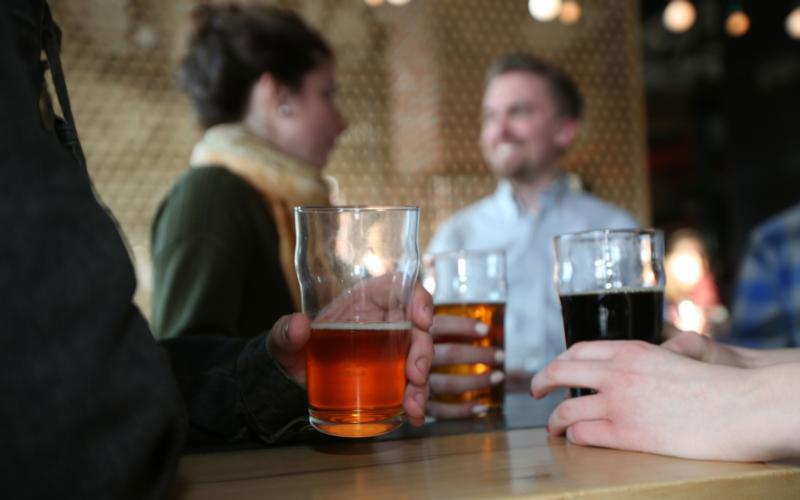 Members of the Catholic Beer Club drink a few pints at Able Seedhouse and Brewery in Minneapolis April 4. (CNS photo by Dave Hrbacek/The Catholic Spirit)