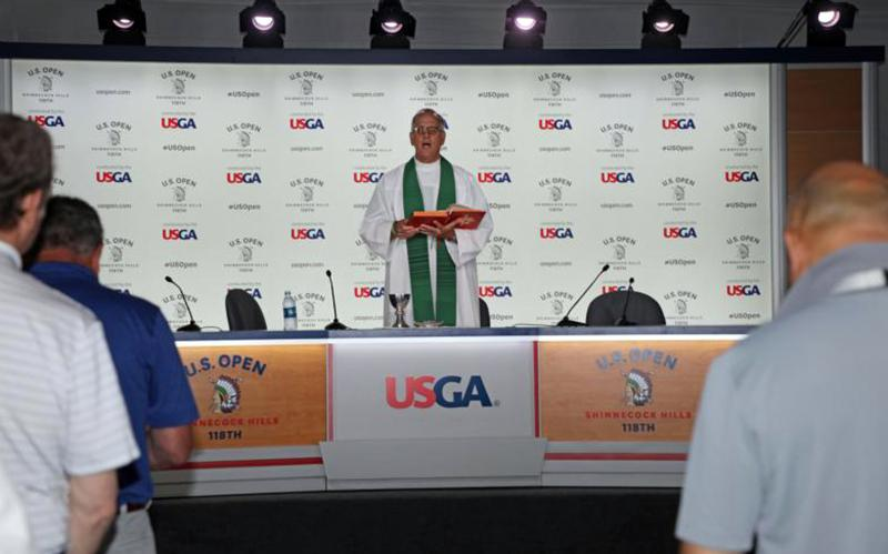06.19.2018  Father Tom Guido, pastor of Resurrection Parish in Miramar Beach, Fla., celebrates Mass June 17 in the U.S. Open media tent at the Shinnecock Hills Golf Club in Southampton, N.Y. Father Guido, who has attended 23 U.S. Opens, traditionally celebrates Sunday morning Mass on the final day of the tournament for journalists who are reporting on the event. (CNS photo courtesy of United States Golf Association)