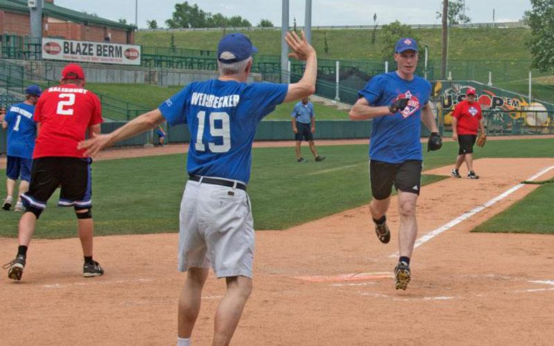Father James Weeder from the Archdiocese of Omaha, Neb., sprints toward home plate to complete his three-run homer in the first inning of the annual I-80 Collar Series softball game June 17 in Lincoln, Neb. The archdiocesan priests posted a 20-18 win over priests from the Lincoln Diocese, their first victory in four years of the series, which is held to promote vocations. (CNS photo by Dan Rossini, Catholic Voice)