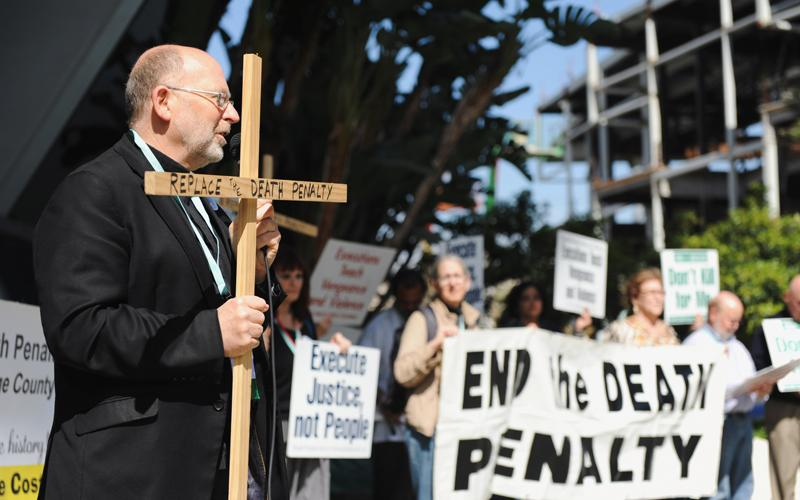Father Chris Ponnet, chaplain at the St. Camillus Center for Spiritual Care in Los Angeles, speaks during a rally protesting the death penalty in Anaheim, Calif., Feb. 25, 2017. Pope Francis has ordered a revision to the catechism to state that the death penalty is inadmissible and he committed the church to its abolition. (CNS photo by Andrew Cullen/Reuters)