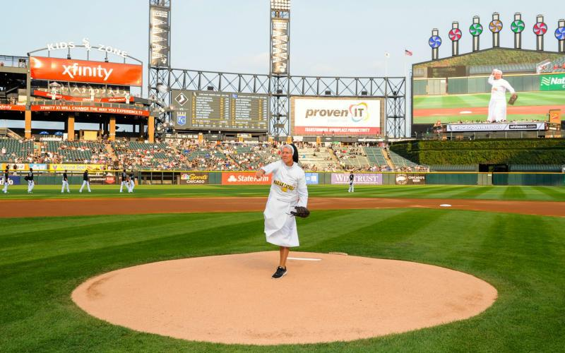 Dominican Sister Mary Jo Sobieck, a theology teacher at Marian Catholic High School in Chicago, throws out the ceremonial first pitch during the Chicago White Sox and Kansas City Royals game Aug. 18 in Chicago. Sister Mary Jo, an athlete and graduate of Cathedral High School in St. Cloud, Minn., bounced the ball off her arm before coming to a set position and letting loose with a curveball. (CNS photo by Anthony Peter/Chicago White Sox)