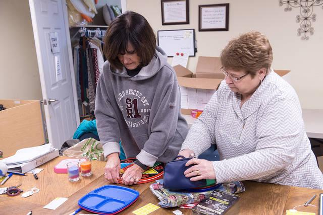 <p>Kathi Noon and Patti Frawley sort items to be placed on the shelves at Life Solutions of Hamlin Jan. 10.  (Courier photo by John Haeger) </p>