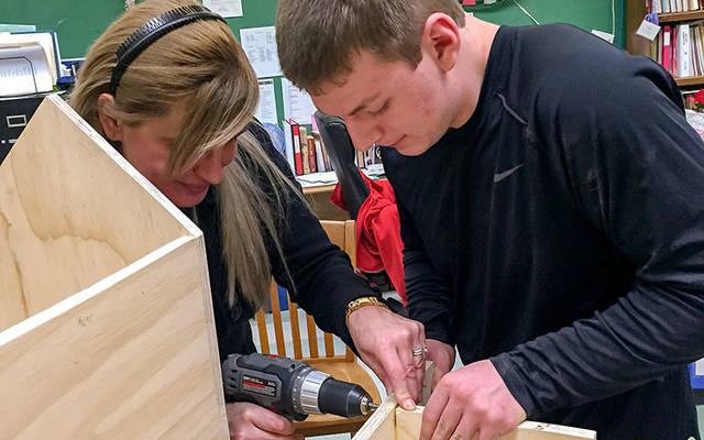 <p>Kathryn Hadyk and John Nesbit construct a blessing box for St. Francis and St. Clare Parish in Waterloo and Seneca Falls Feb. 27, 2017. (Photo courtesy of Jennifer Cornwell)  </p>