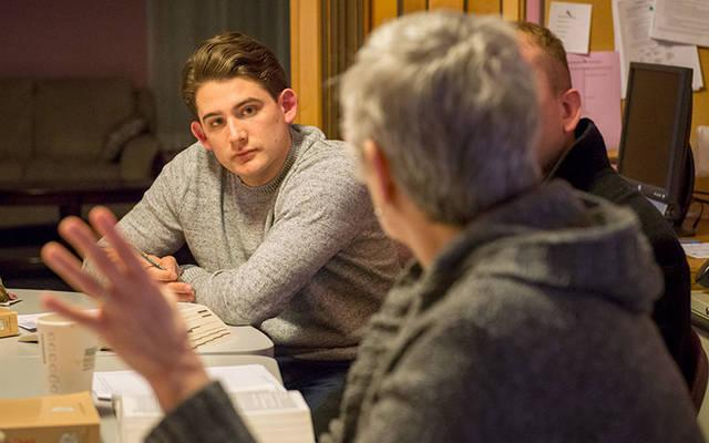 <p>Collin Doane listens during a Feb. 19 discussion on the real presence of Christ in the Eucharist at Blessed Sacrament Church in Rochester.  (Courier photo by Jeff Witherow) </p>